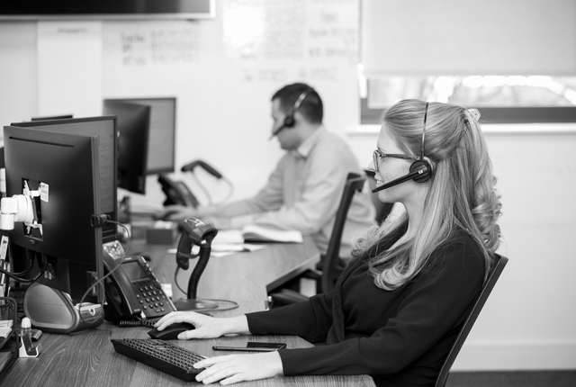 Business colleague chatting to customers on a reliable phone system