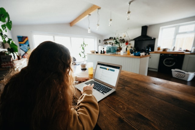 Business woman using telecoms technology to work from home post COVID-19