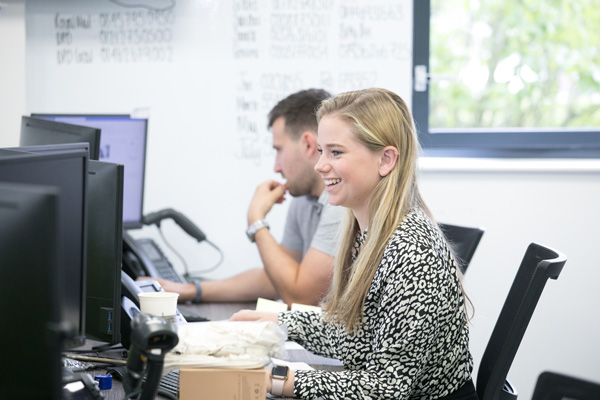Katie Price delivering a free business telecommunications quote to a client