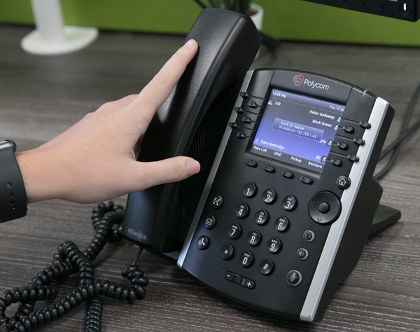 A Croft Communications team member answering a call on a business VoIP system