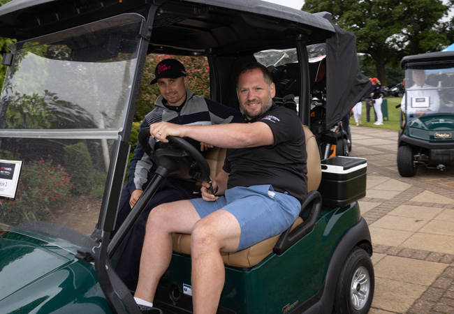 Croft Director Ben Page in golf buggy at the ISPS Handa Mike Tindall Celebrity Golf Classic 2021